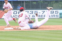 052917 - 013 - Lee County's Tyler Simon tags out a runner trying to steal second base in Game 1